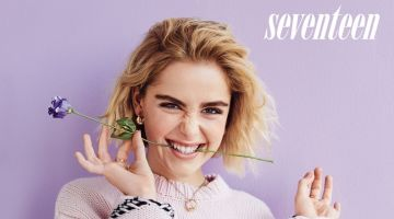 Kiernan Shipka poses in Alanui sweater, Maggie Marilyn pants and Ana Luisa earrings