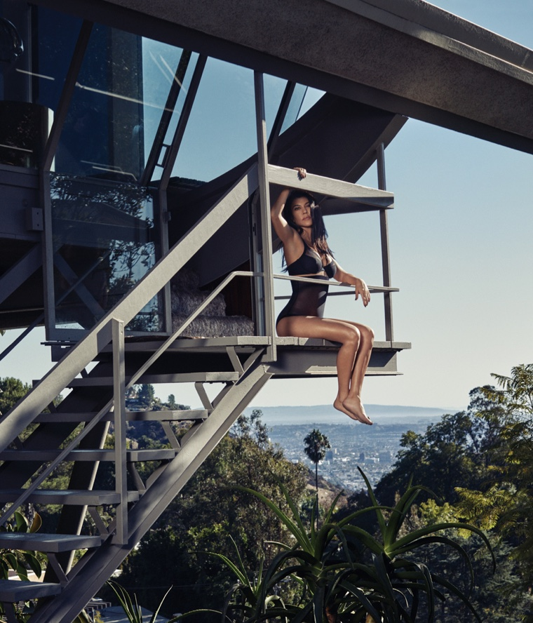Looking over the city, Kourtney Kardashian wears black lingerie