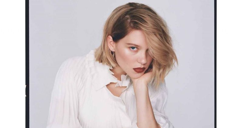 Dressed in white, Lea Seydoux wears Louis Vuitton dress