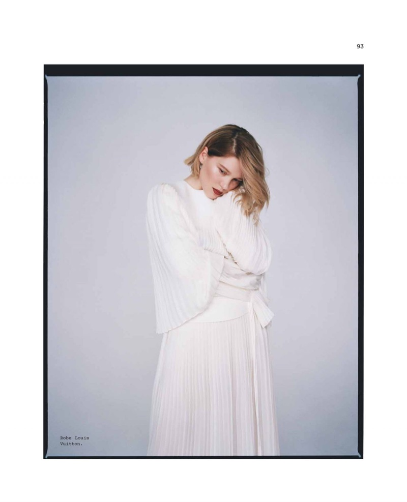 Embracing pleats, Lea Seydoux poses in Louis Vuitton dress