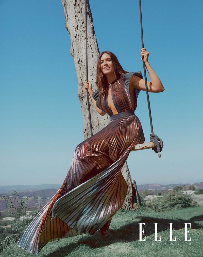 Sitting on a swing, Mandy Moore poses in a pleated Givenchy gown