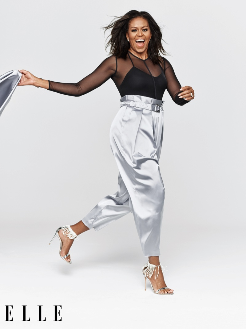 Former First Lady Michelle Obama poses in Sally LaPointe shirt and pants, Ann Demeulemeester bodysuit and Gianvito Rossi sandals