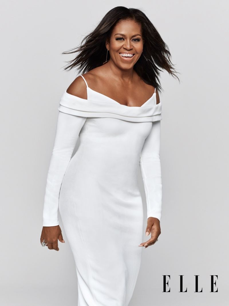 Wearing a Cushnie dress and Jenny Bird earrings, Michelle Obama is all smiles