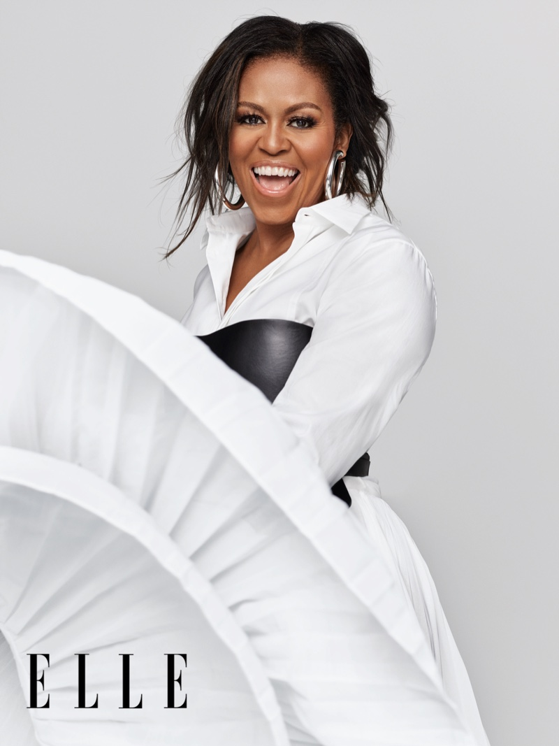 Michelle Obama poses in a full Dior look