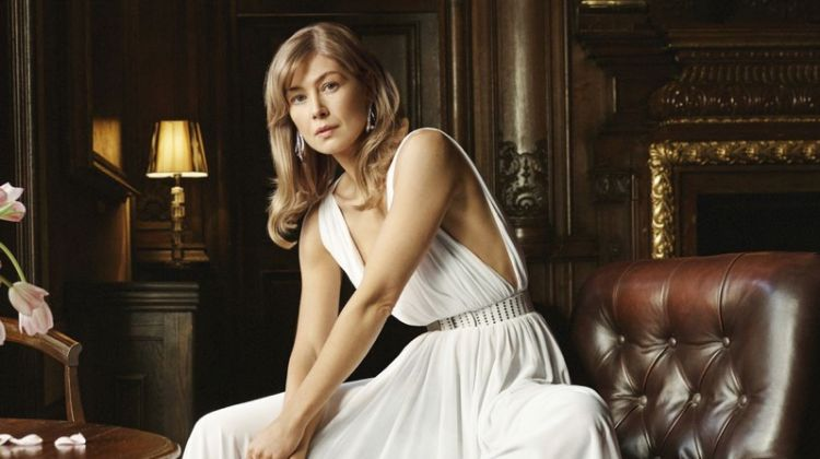 Actress Rosamund Pike wears Maison Alaia Dress, belt and shoes with Graff earrings