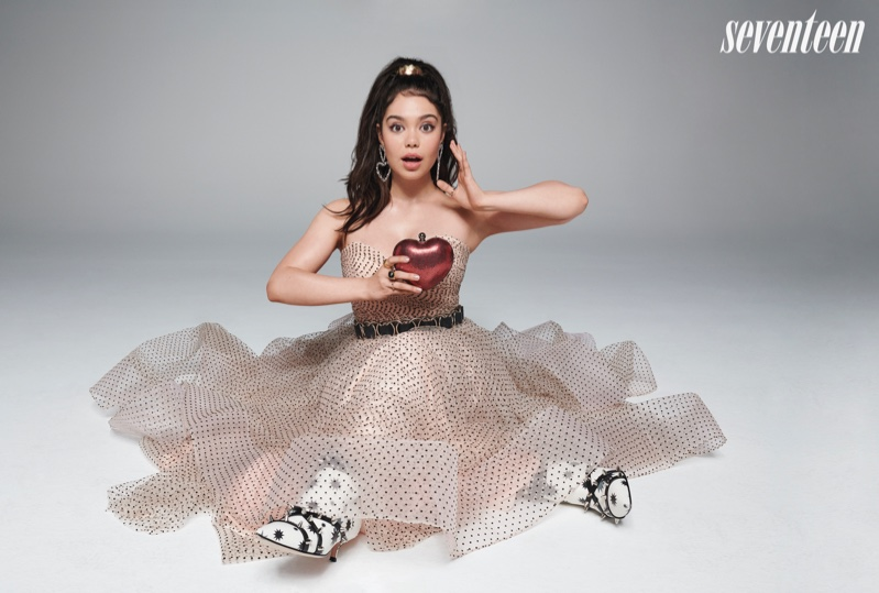 Auli'i Cravalho poses with a red apple for the perfect accessory