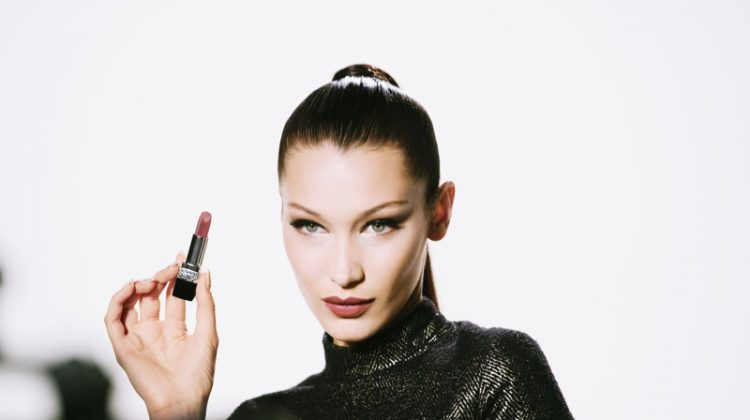 Wearing a sleek ponytail, Bella Hadid poses on set of Rouge Dior Wishes campaign