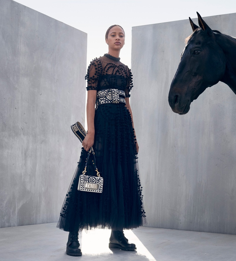 Model Selena Forrest poses with J'Adior bag for Dior cruise 2019 campaign
