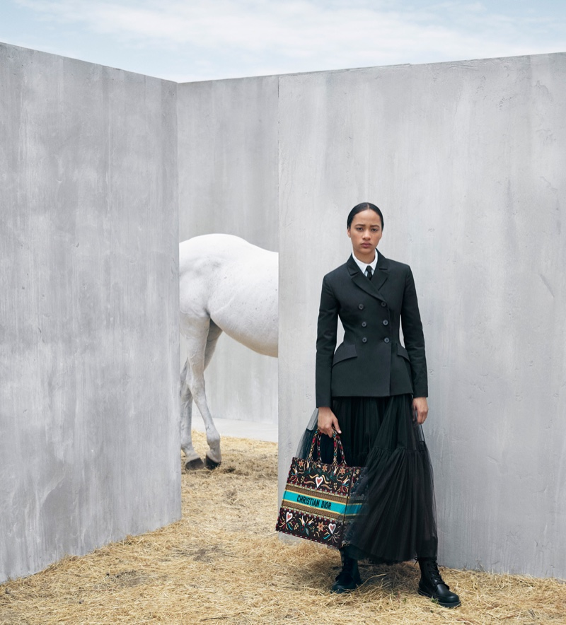 Selena Forrest poses with the Dior Book Tote bag from the brand's cruise 2019 collection