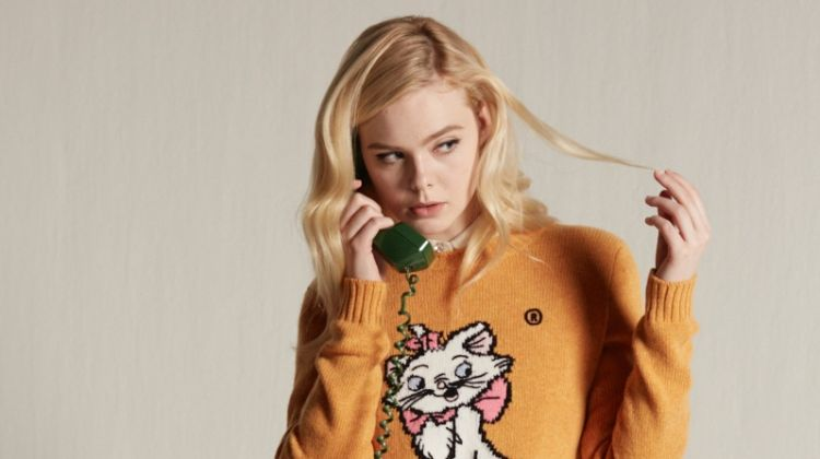 dd242f4cc2a Elle Fanning wears Miu Miu Little Cats sweater collection