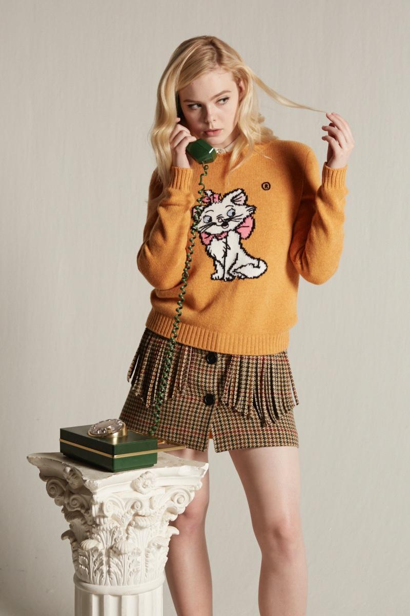 605defb5778 Elle Fanning wears Miu Miu Little Cats sweater collection