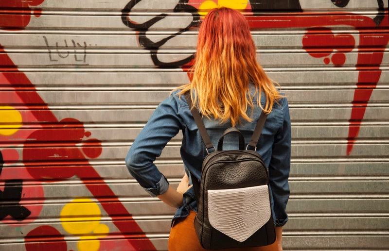 Girl with Red Hair and Backpack