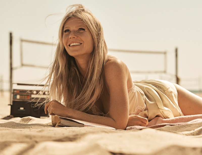 All smiles, Gwyneth Paltrow poses on the beach
