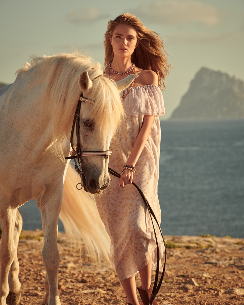 Posing with a horse, Anna Mila Guyenz appears in Hemisphere Cashmere spring-summer 2019 campaign