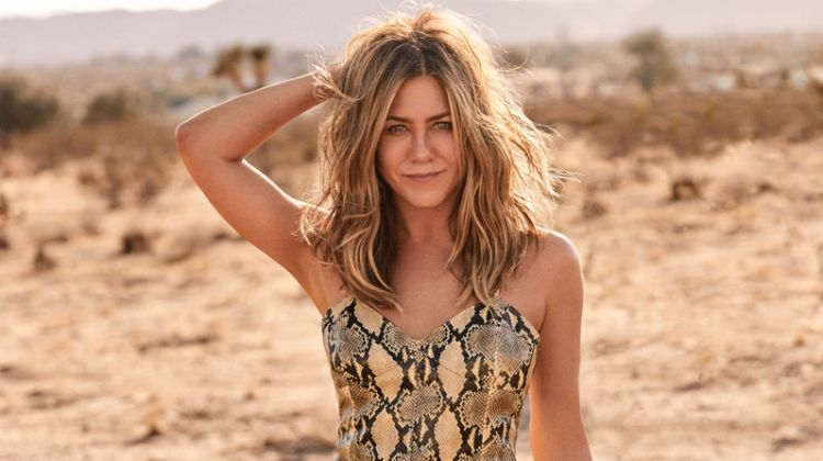 Actress Jennifer Aniston poses in python print Gucci leather dress