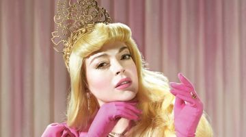 Lindsay Lohan poses in Gorge Keburia jacket and gloves with The Shiny Squirrel tiara