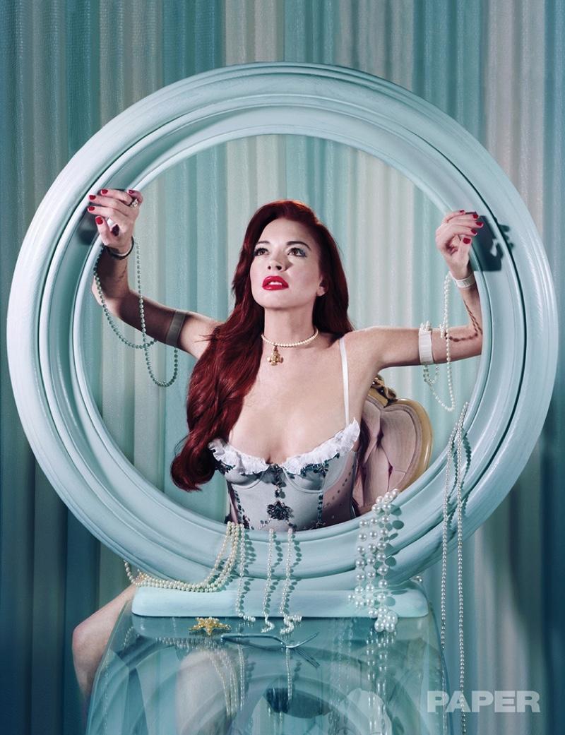 Looking like a mermaid, Lindsay Lohan wears TDF Costumes bodysuit and pearls