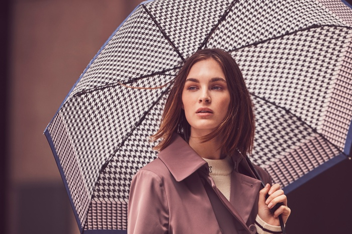 Posing with an umbrella, Laura Love appears in London Fog fall-winter 2018 campaign