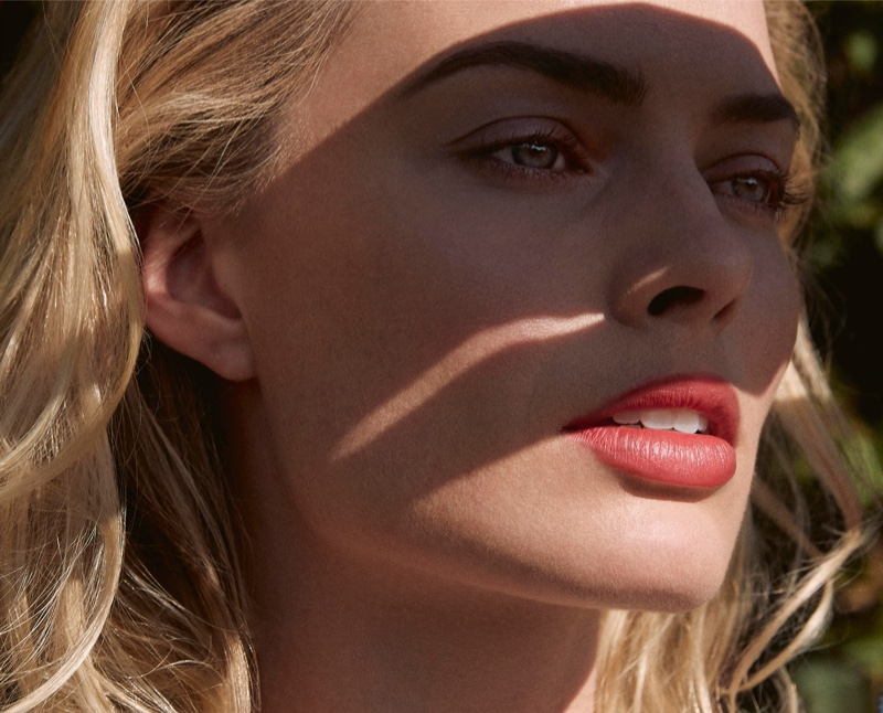 Facing the sun, Margot Robbie shows off a coral pout