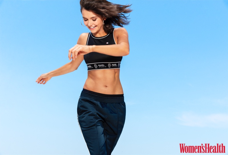 Actress Nina Dobrev wears Champion bra and Urban Outfitters pants