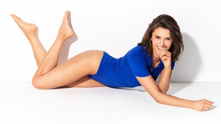 Flashing a smile, Nina Dobrev wears a blue bodysuit