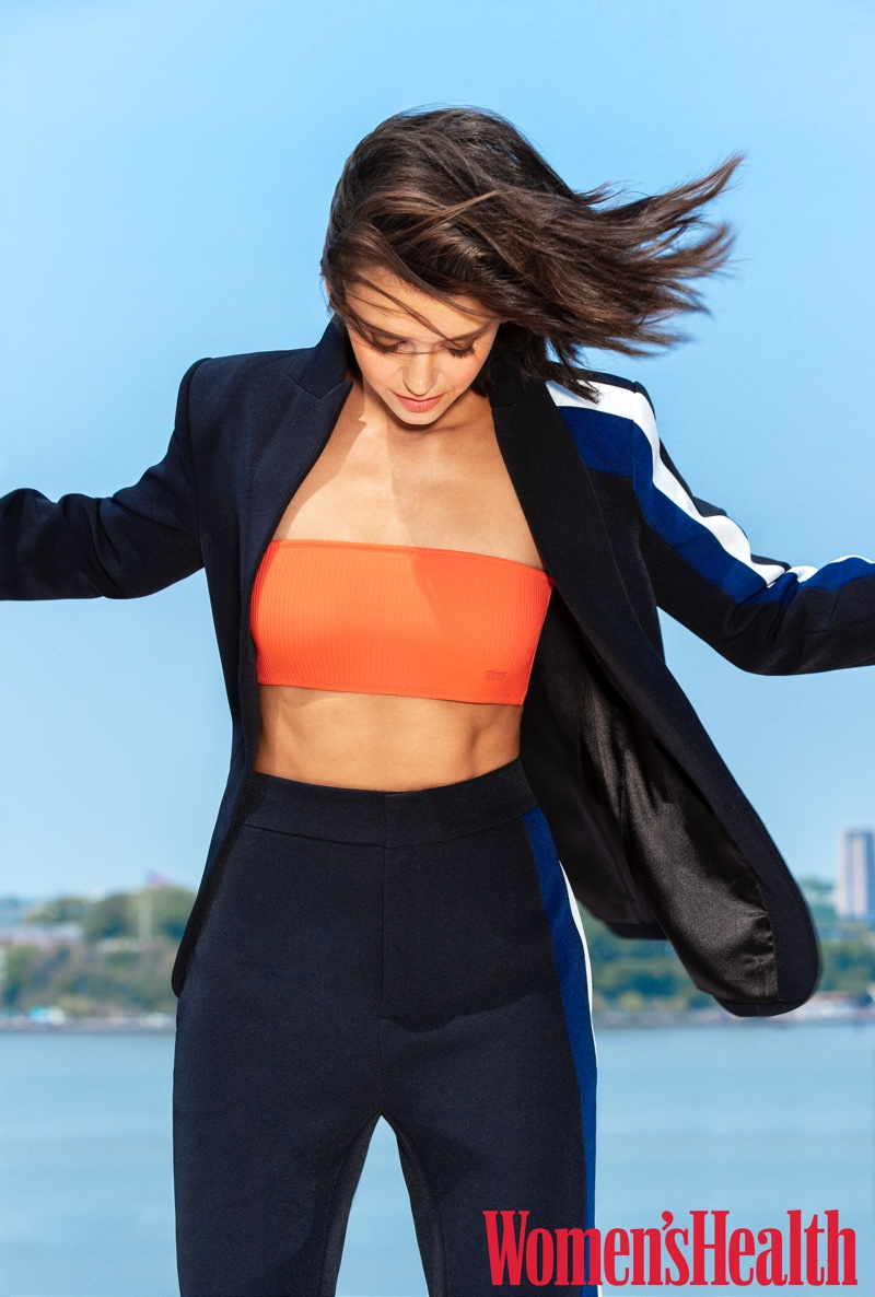Actress Nina Dobrev poses in Rachel Rachel Roy blazer and pants with Triangl top