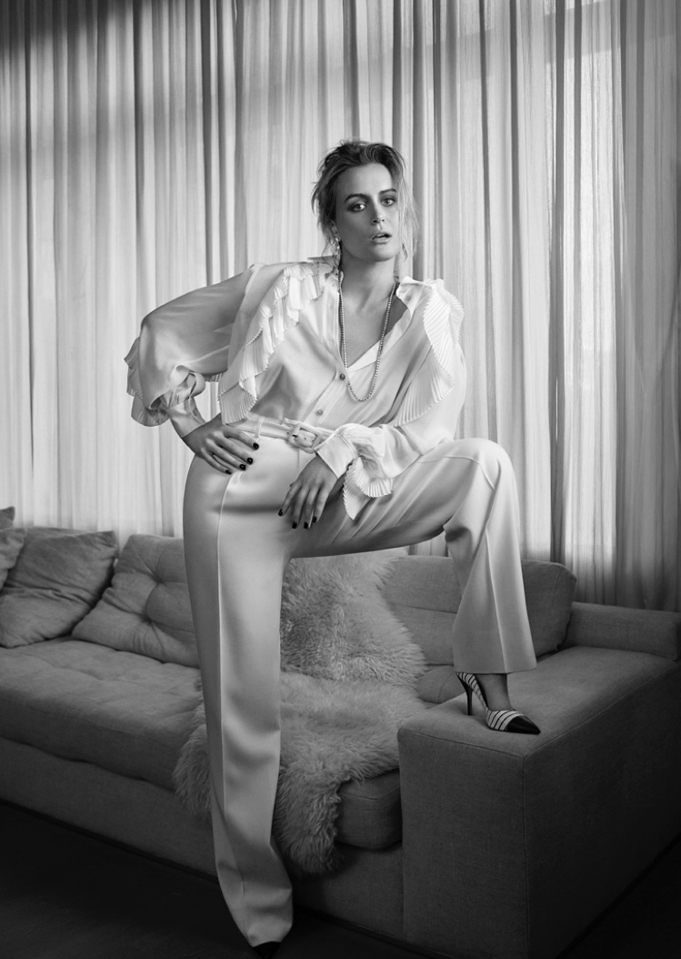 Striking a pose, Taylor Schilling wears Givenchy top and pants
