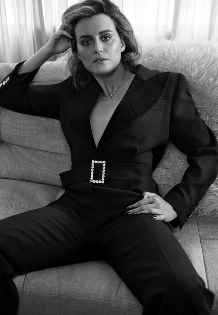 Photographed in black and white, Taylor Schilling wears Tom Ford jumpsuit