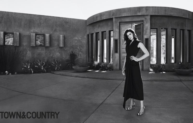 Anne Hathaway poses in Dries Van Noten dress and heels