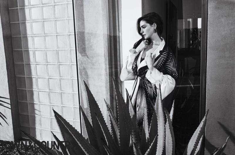 Anne Hathaway poses in Haider Ackermann dress and Vhernier earrings