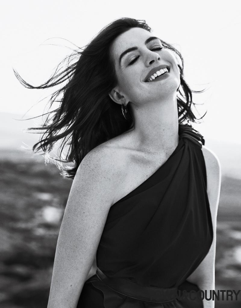 Actress Anne Hathaway wears Max Mara dress and Vhernier earrings