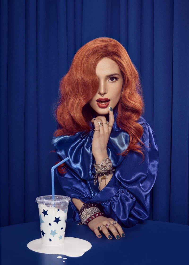 Bella Thorne stands out in a blue top