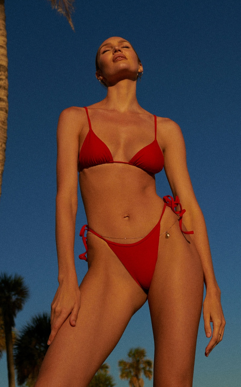 Looking red-hot, Candice Swanepoel poses in Tropic of C triangle bikini set