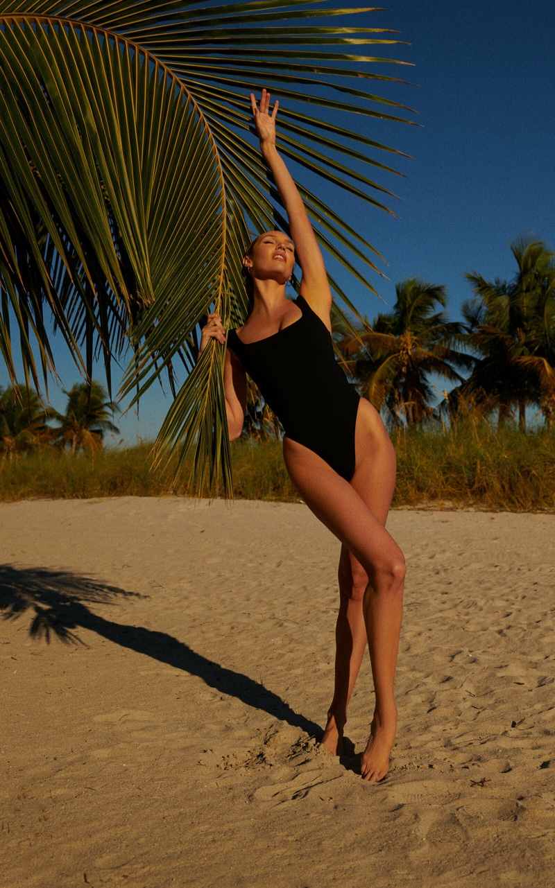 Flaunting her long legs, Candice Swanepoel models Tropic of C Scorpio racerback one piece