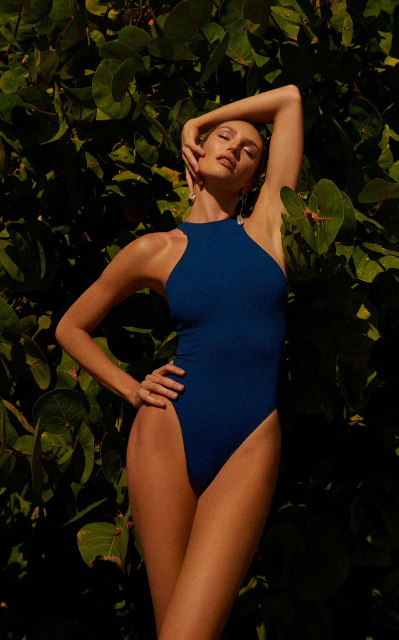 Wearing Tropic of C's Contour swimsuit, the South African model shows off her design on the beach