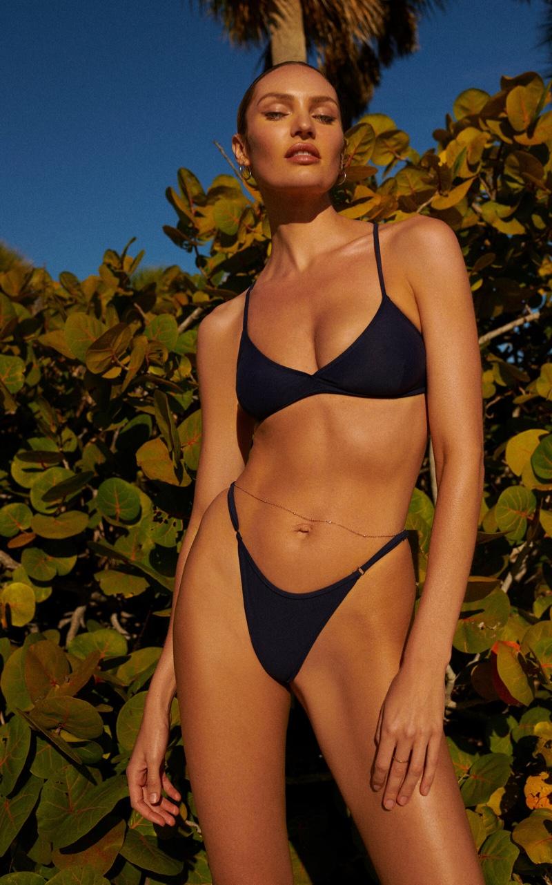 Candice Swanepoel poses in black bikini set from Tropic of C