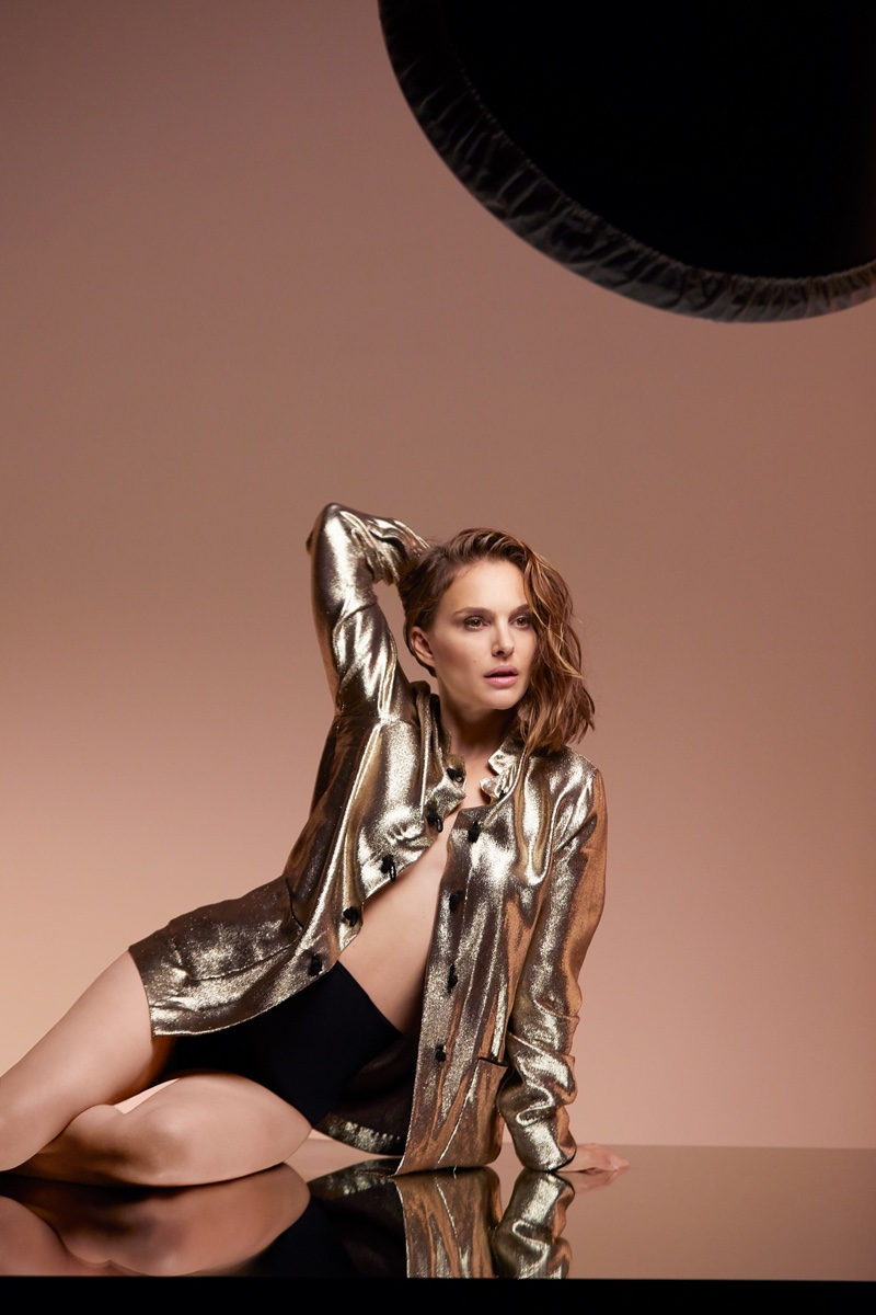 Actress Natalie Portman poses in gold shirt on set of Dior Forever shoot