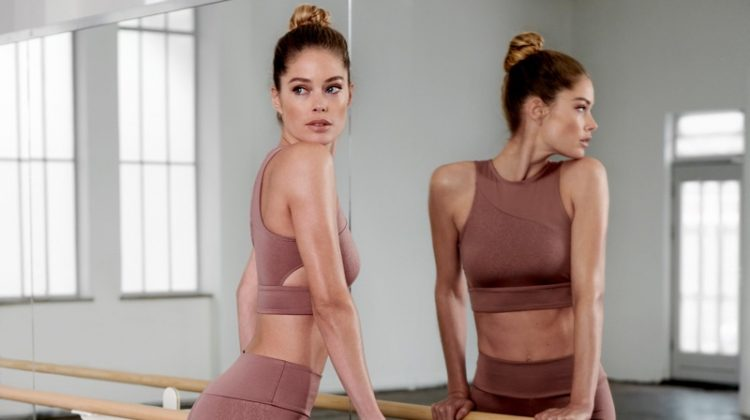 Wearing a ballet inspired outfit, Doutzen Kroes poses in her activewear collaboration with Hunkemoller