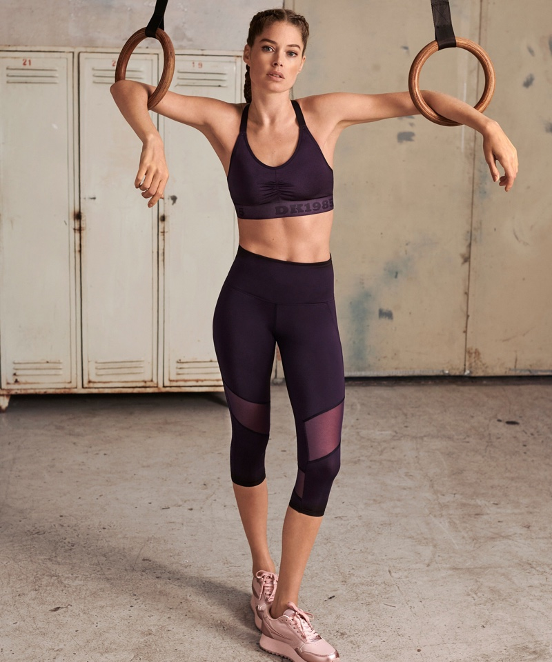 Posing with rings, Doutzen Kroes shows off her toned figure for DK1985 Sport campaign