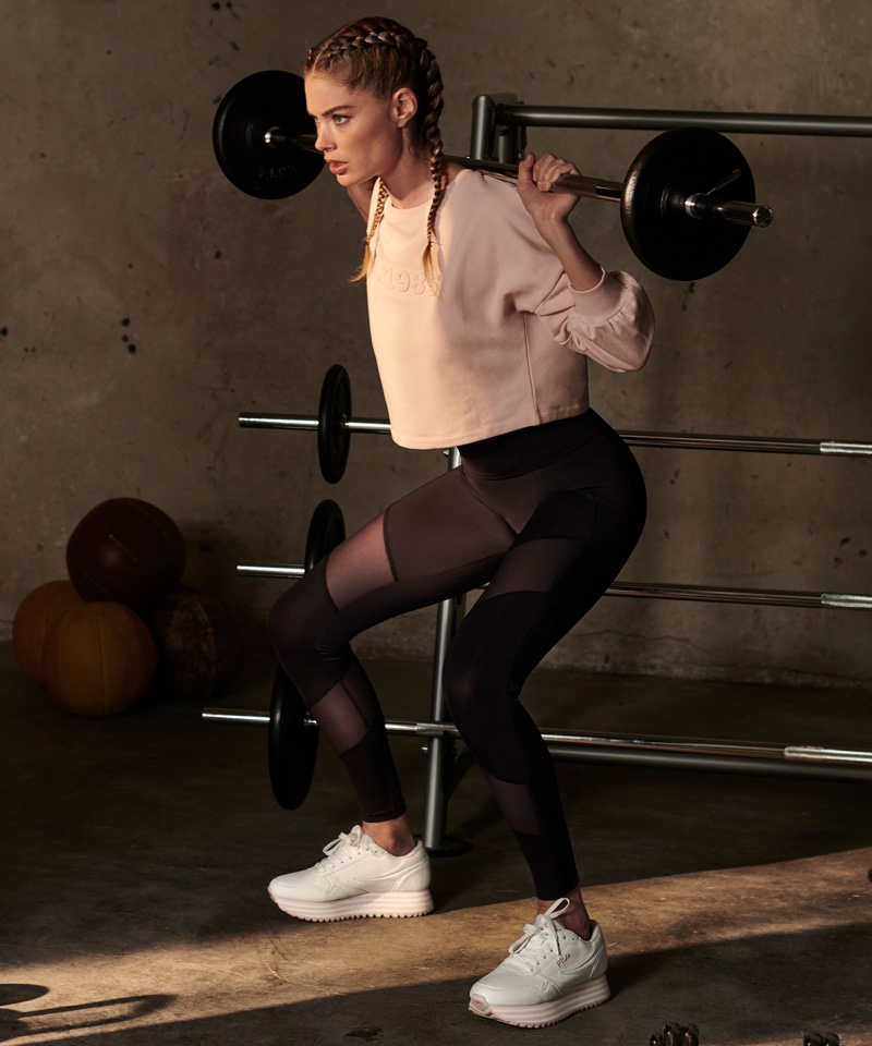 Pumping some iron, the Dutch model shows off her workout routine