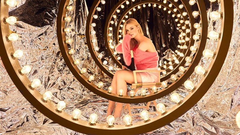 Actress Elle Fanning poses with stage lights for Miu Miu Twist promotional image