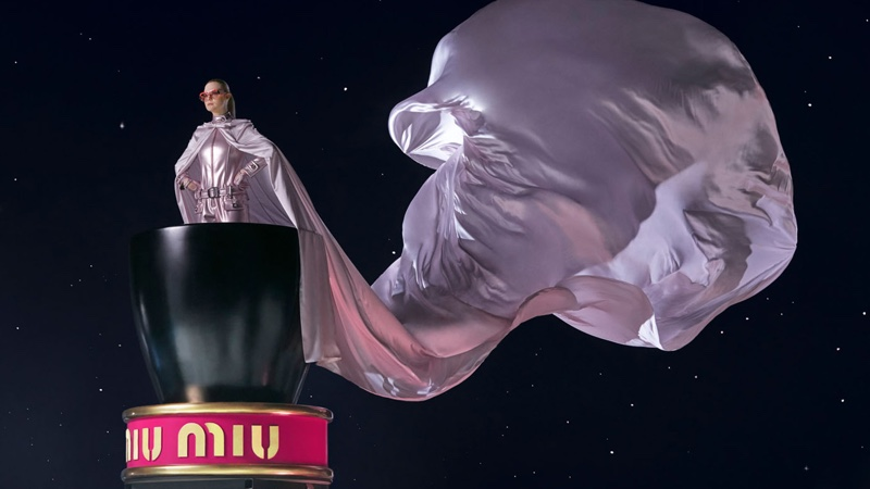 Wearing a cape, Elle Fanning fronts Miu Miu Twist fragrance