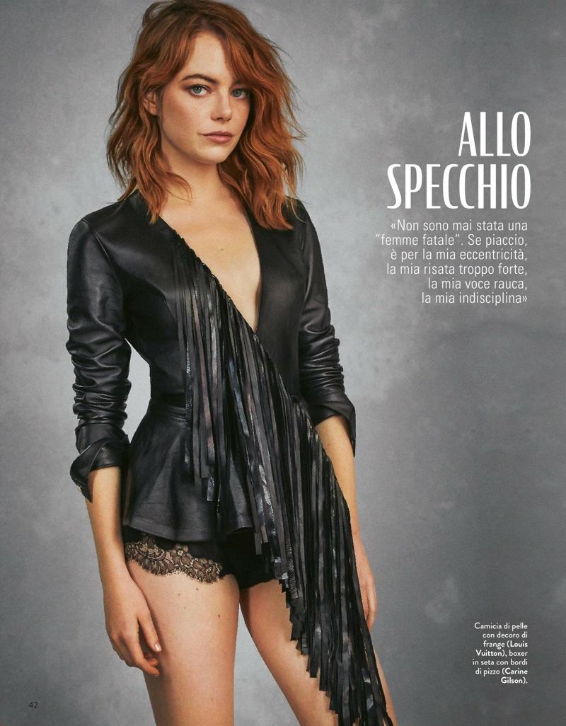 Dressed in black, Emma Stone wears Louis Vuitton top
