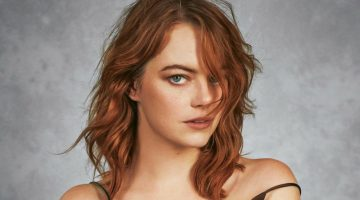 Emma Stone poses in a Louis Vuitton dress