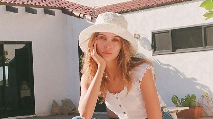 Free People Marilyn Eyelet Bucket Hat $48, Louie Louie Tee $48 and We The Free Daisy Jeans $168
