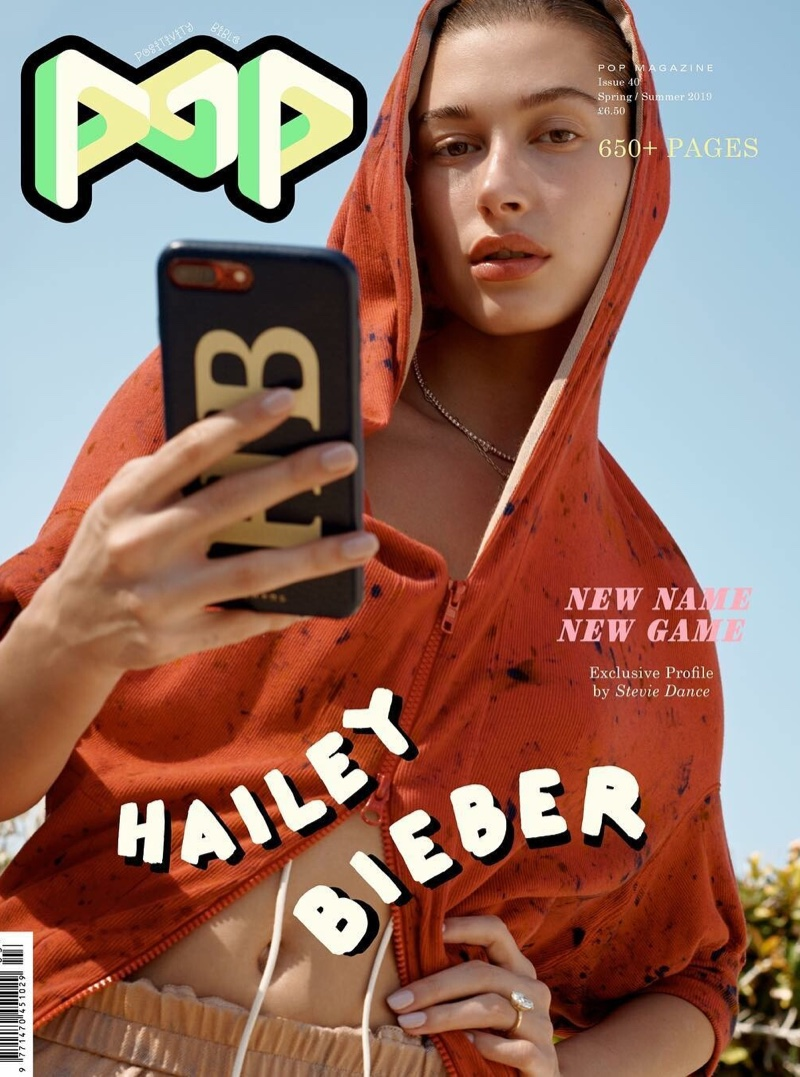 Hailey Baldwin poses with a cellphone on POP Magazine Spring/Summer 2019 Cover
