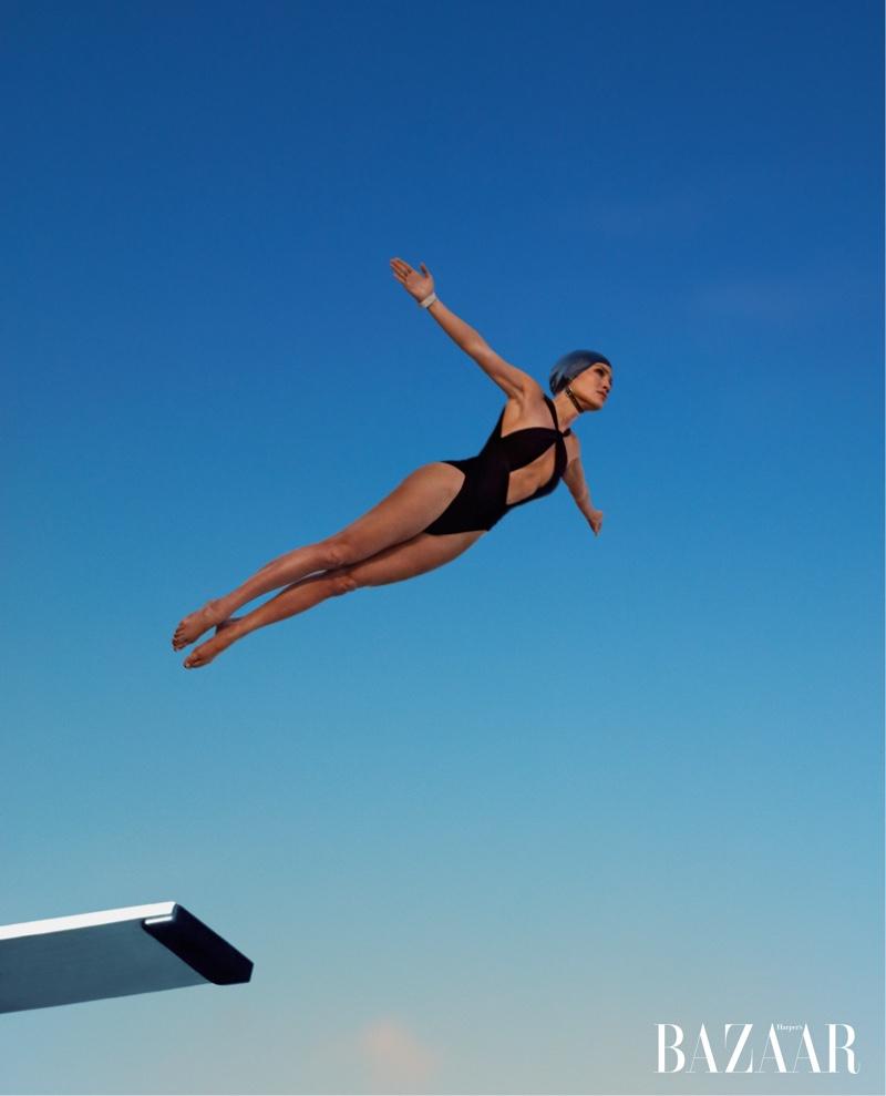 Taking a dive, Jennifer Lopez wears Saint Laurent bodysuit