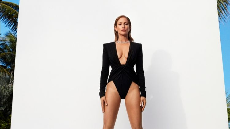 Flaunting her legs, Jennifer Lopez poses in Saint Laurent sunglasses and heels