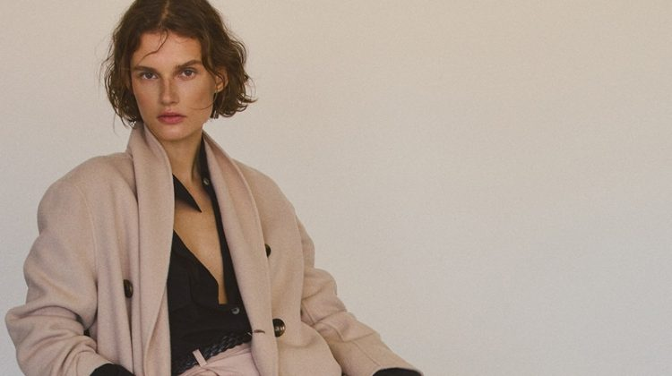 Giedre Dukauskaite wears wool coat and trousers from Massimo Dutti