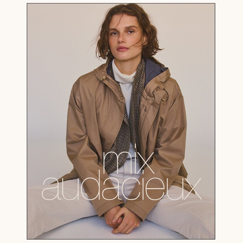 Giedre Dukauskaite poses in parka and wool blazer from Massimo Dutti